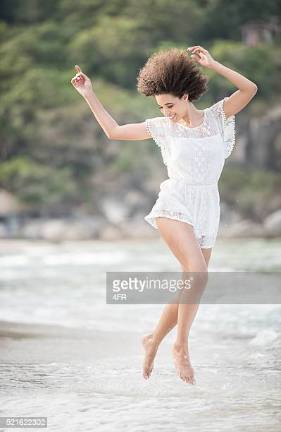Lifestyle Fashion, Mixed Race Woman at the Beach on Vacation