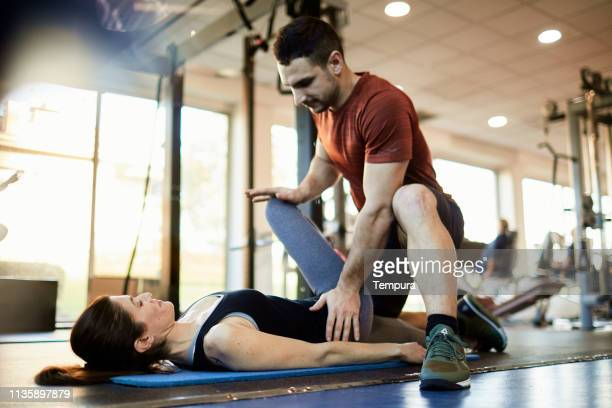 lifestyle  gym and fitness barcelona, warmup and stretching. - physiology stock pictures, royalty-free photos & images