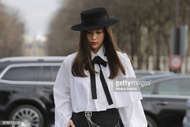 Lifestyle influencer Kieunse seen wearing Chanel at the Chanel fashion show during Paris Fashion Week Womenswear Fall/Winter 2018/2019 on March 6...
