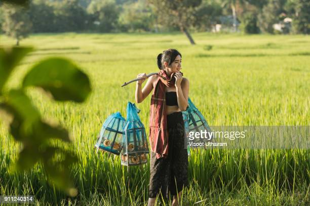Lifestyle of rural Asian women in the field countryside