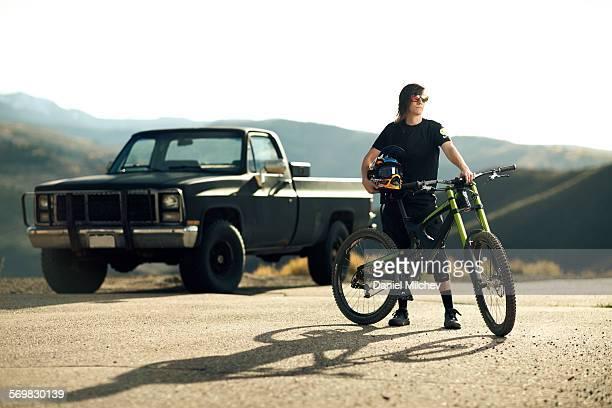 Lifestyle photo of a female mountain bike rider.