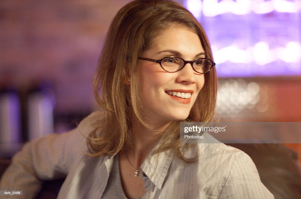 lifestyle photograph of an attractive caucasian female in glasses as she smiles : Stockfoto