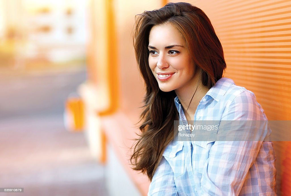 Lifestyle portrait happy pretty young woman outdoors in city : Stock Photo