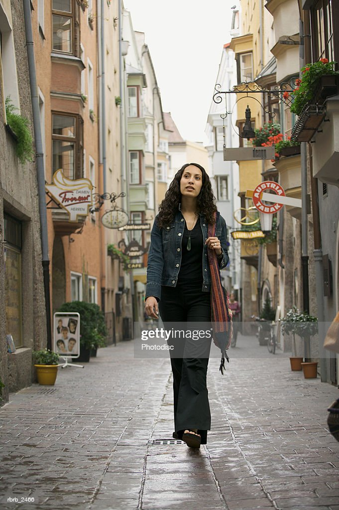 lifestyle portrait of a young adult woman as she goes sightseeing while visiting europe : Stockfoto