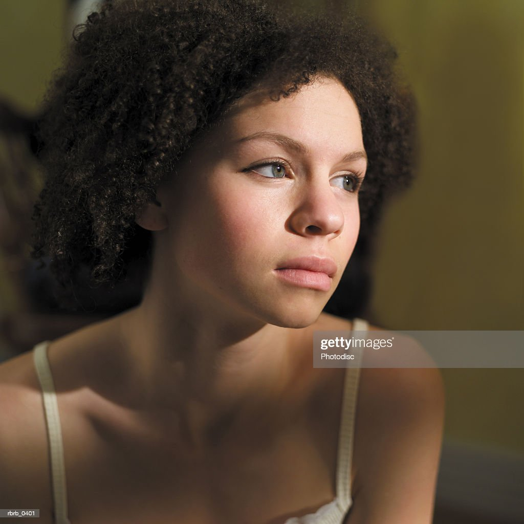 lifestyle portrait of an attractive young african american woman in a white tank top : Stockfoto