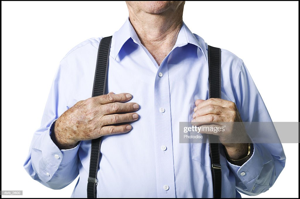 lifestyle portrait of an elderly male as his hands confidently grab his suspenders : Foto de stock