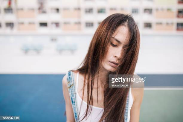 Lifestyle Portrait of Eurasian Woman Thinking