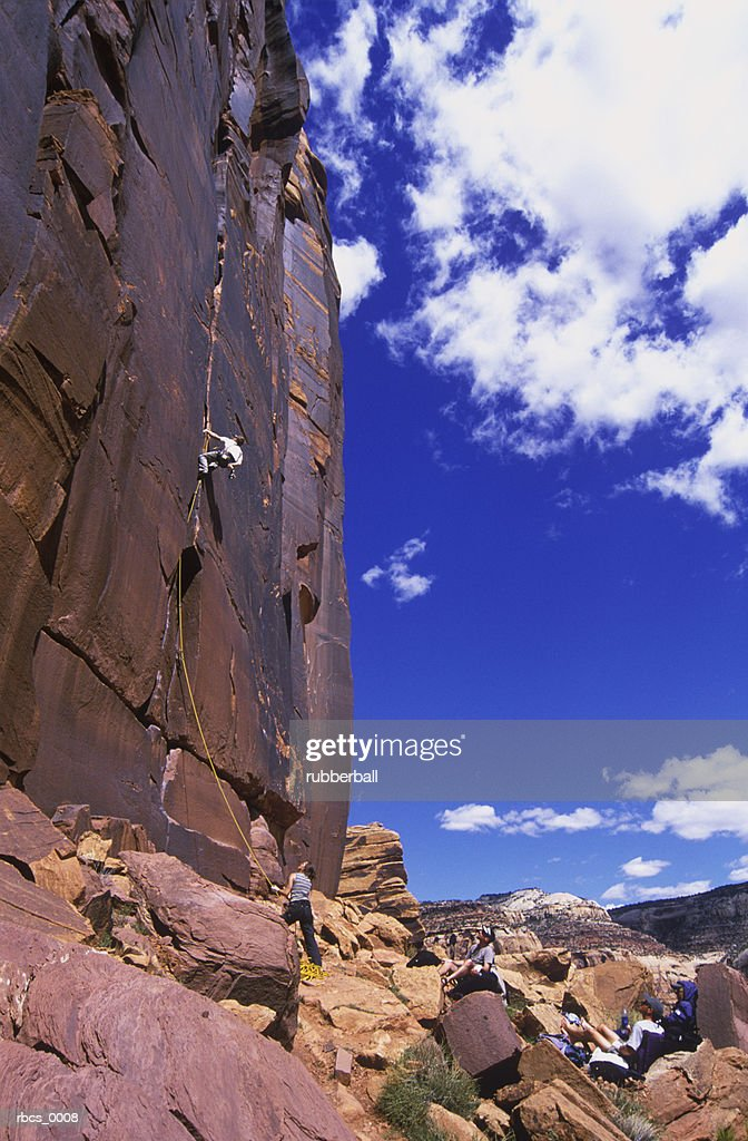 lifestyle shot of a group of young adults as they get together and go rock climbing : Stockfoto