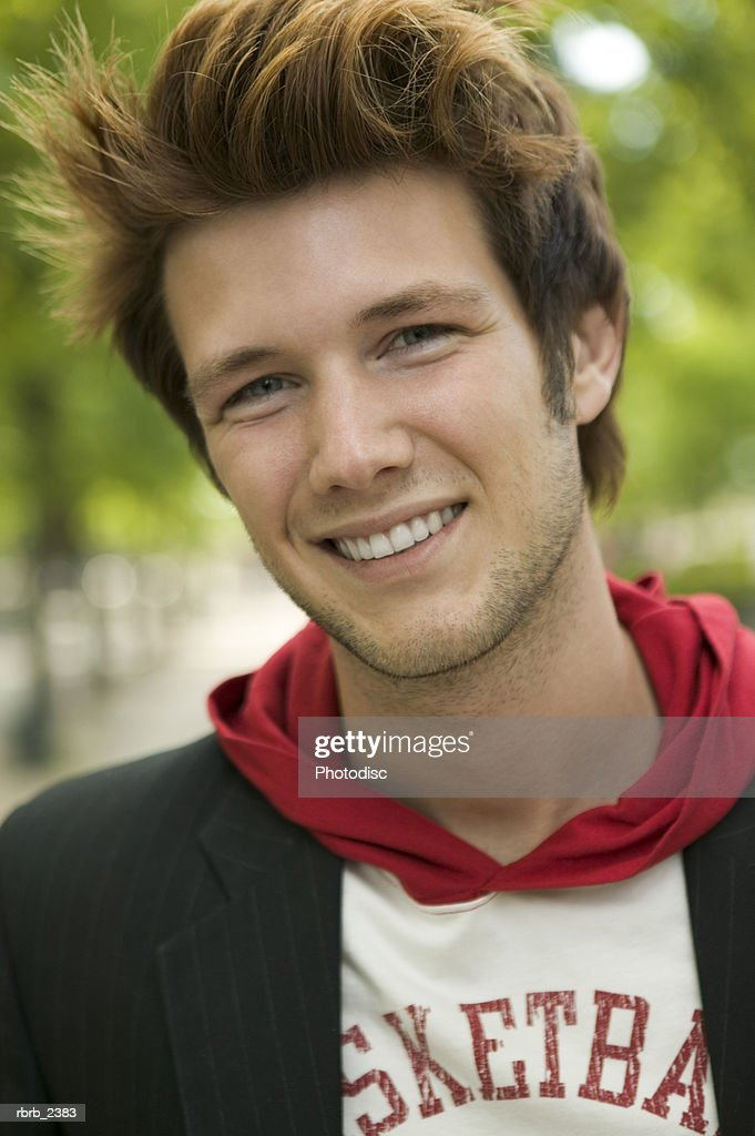 lifestyle shot of a stylish young adult male as he smiles at the camera : Foto stock