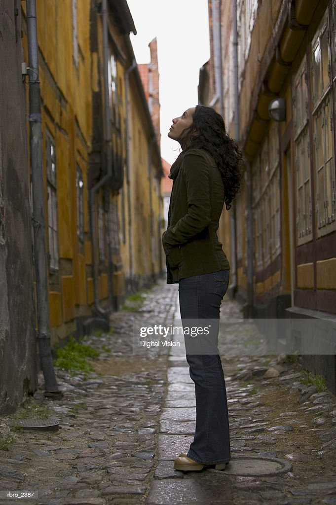 lifestyle shot of a young adult woman as she goes sightseeing on a european street : Foto de stock