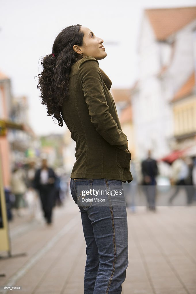 lifestyle shot of a young adult woman as she goes sightseeing while on vacation : Foto de stock