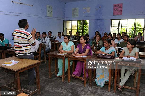 LifestyleAsiaeducationIndiaFEATURE by Adam Plowright In a picture taken on August 30 an instructor addresses students at a teacher traning workshop...