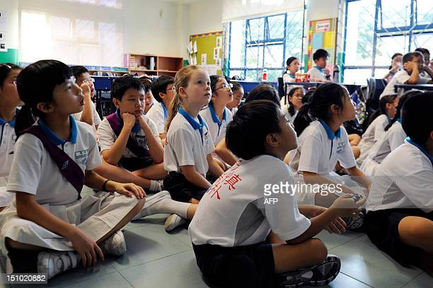 STORY 'LifestyleAsiaeducationSingaporeChinaFEATURE' by Simin WANG This photo taken on May 15 2012 shows Happy Rogers the daughter of US investor Jim...
