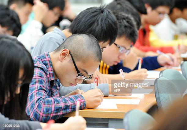 STORY LifestyleAsiaeducationTaiwanuniversityFEATURE by Peter Harmsen This picture taken on August 25 shows high school students studying at a cram...
