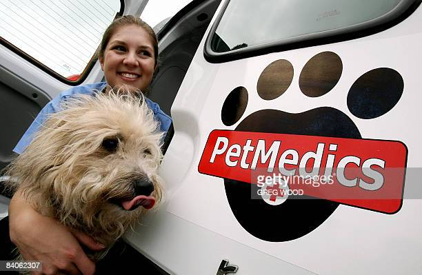 STORY LifestyleAustraliaanimalspetshealth by Glenda Richard Niccole George holds her friend's dog 'Kirby' as she sits in her pet ambulance in Sydney...