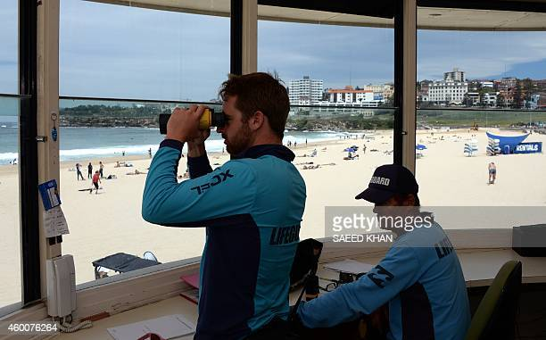 LifestyleAustraliabeachlifesavingtechnologyFEATURE by Madeleine Coorey This picture taken on October 28 2014 shows lifeguards monitoring surfers at...