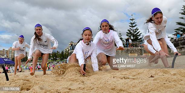 LifestyleAustralialifesavingFEATURE by Madeleine Coorey Young children dive to grab the pegs as they participate in what is called a surf lifesaving...