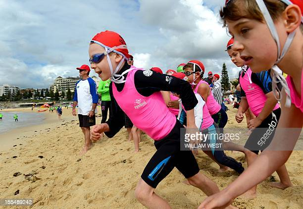 LifestyleAustralialifesavingFEATURE by Madeleine CooreyYoung children run to the surf as they participate in what is called a surf lifesaving school...