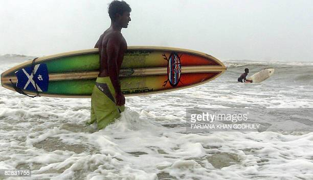 STORY 'LifestyleBangladeshsurfingFEATURE' by Julie Clothier Bangladeshi surfer Jafar Alam prepares to surf in the waters of The Bay of Bengal at...