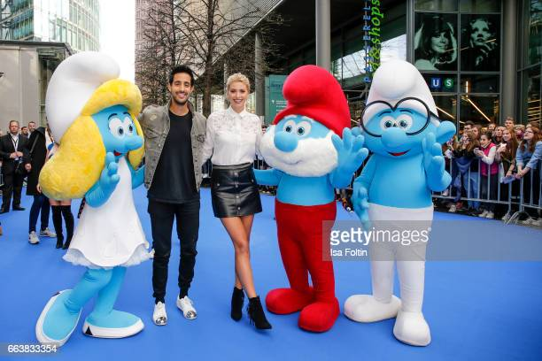 LifestyleBlogger Sami Slimani and model Lena Gercke with smurfs during the 'Die Schluempfe Das verlorene Dorf' premiere at Sony Centre on April 2...