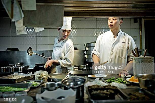LifestyleChinafoodtourism FEATURE by Marianne Barriaux In a picture taken on June 8 2010 Chinese chef Yu Bo cooks in his restaurant 'Yu's Family...
