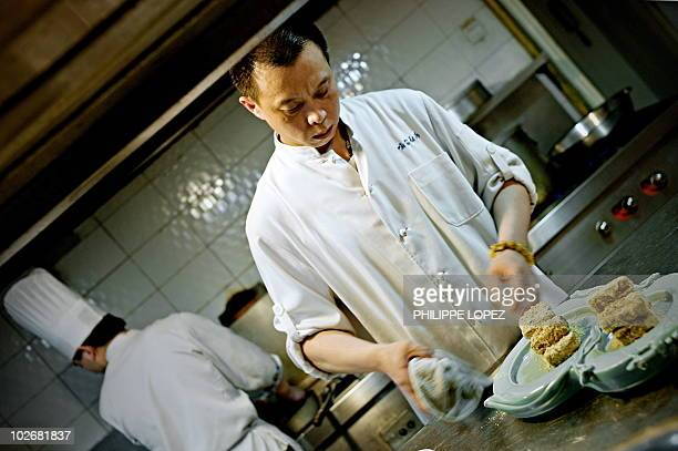 "Lifestyle-China-food-tourism FEATURE by Marianne Barriaux In a picture taken on June 8, 2010 Chinese chef Yu Bo cooks in his restaurant ""Yu's Family..."
