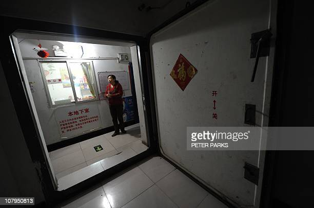 LifestyleChinapropertyinflationsocialFEATURE by Dan MartinThis photo taken on January 5 2011 shows a resident standing at the entrance to a dimly lit...