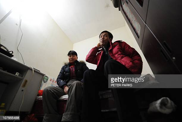 LifestyleChinapropertyinflationsocialFEATURE by Dan MartinThis photo taken on January 5 2011 shows Chinese migrant worker Li Youhong sitting with his...