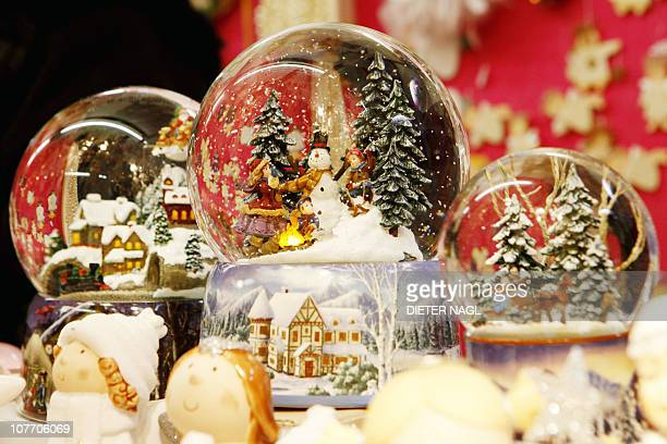 STORY 'LifestyleChristmasAustriasnowglobes' FEATURE by Sim Sim WissgottThis picture taken on December 10 shows snowglobes are displayed at a stall in...
