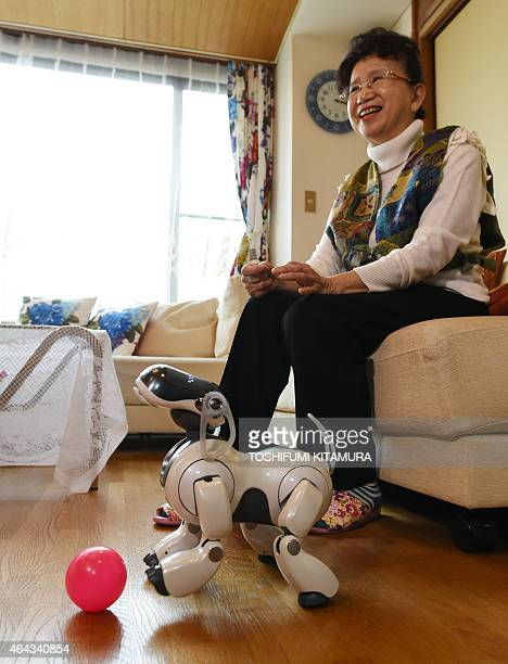 LifestyleelectronicsJapanrobotSony by Miwa Suzuki Hideko Mori speaks as her robot pet AIBO playing beside her after she asked 'AFun' company to...