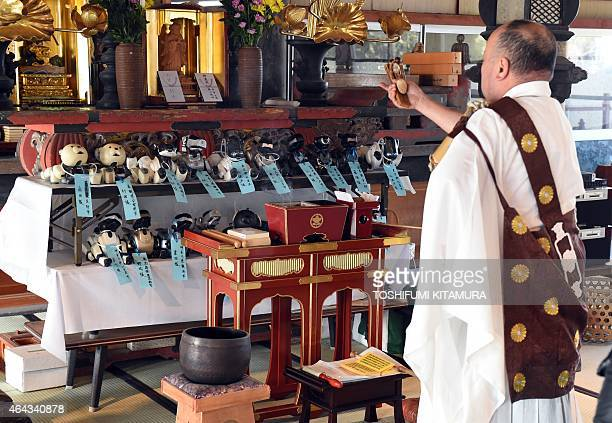 LifestyleelectronicsJapanrobotSony by Miwa Suzuki Kofukuji temple chief priest Bungen Oi offers a prayer during the funeral for 19 Sony's pet robot...