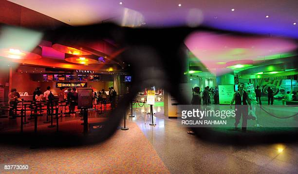 Lifestyleentertainmentfilmcinema3DHollywood by Martin Abbugao People are pictured through a 3dimentional eyeware outside a cinema in Singapore on...