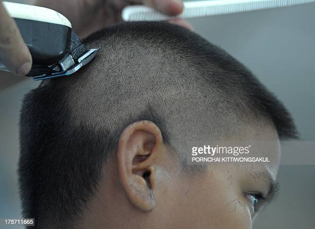 LifestylehairThailandFEATURE by Apilaporn VECHAKIJ This photo taken on July 31 2013 shows a Thai barber shaving the head of student at a...