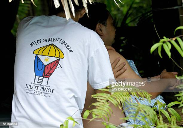"""Lifestyle-health-Philippines-medicine"""" by Jason Gutierrez A member of the Hilot Pinoy movement works the back of a patient to stimulate blood..."""