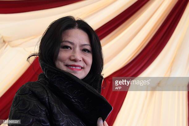 STORY 'LifestyleHongKongChinaUSfashionpeopleTamINTERVIEW' by Joyce Woo Hong Kong designer Vivienne Tam poses for a picture at a press event prior to...