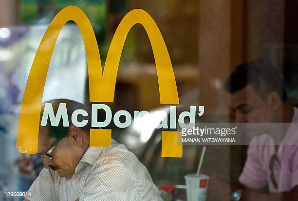 LifestyleIndiahealthobesityfoodFEATURE by Adam Plowright People eat at an Indian McDonalds fast food outlet in New Delhi on October 4 2011 Every...