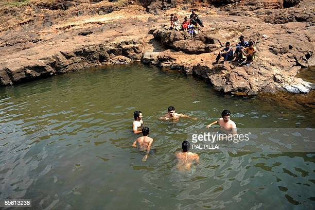 LifestyleIndiatourismFEATURE by Phil Hazlewood Young Indian city dwellers are watched by local children as they swim in a river during their stay in...