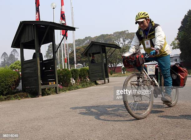STORY LifestyleNepalcyclingEverest by Subel Bhandari Nepalese cyclist Pushkar Shah arrievs at The President's House in Kathmandu on April 7 as he...