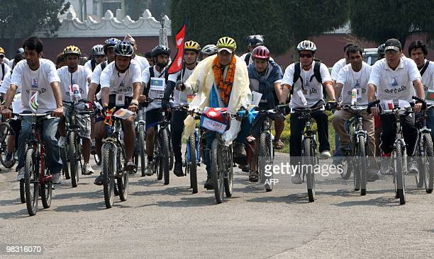STORY LifestyleNepalcyclingEverest by Subel Bhandari Nepalese cyclist Pushkar Shah holds a Nepalese flag as he cycles with supporters in Kathmandu on...