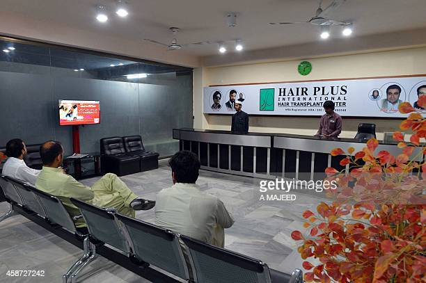 LifestylePakistanhealthhairoffbeatFEATURE BY Guillaume LAVALLÉE This photograph taken on October 16 shows Pakistani men waiting their turn at a hair...