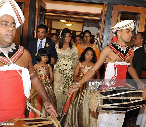 "Lifestyle-SriLanka-weddings"" by Mel Gunasekera A pair of Sri Lankan traditional kandyan dancers walk ahead of a bride at a lavish wedding party in..."