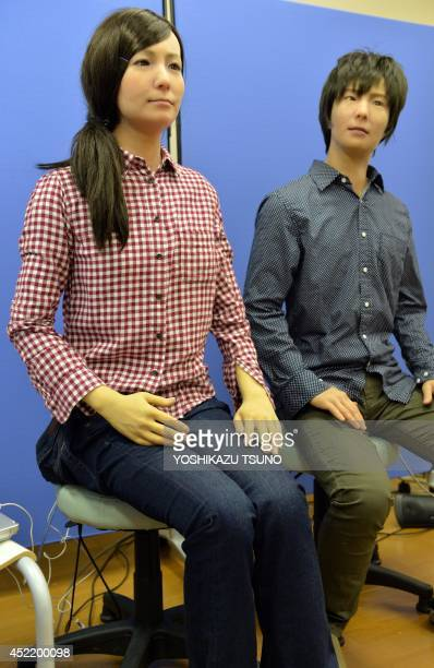 LifestyletechnologyroboticsJapanethicsFEATURE by Alastair Himmer This picture taken on July 8 2014 shows male and female humanoid robots called...
