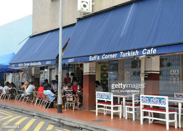 STORY 'LifestyletravelMuslimreligion' This photograph taken on January 15 2013 shows rows of halal Muslim food restaurants next to Arab street in...
