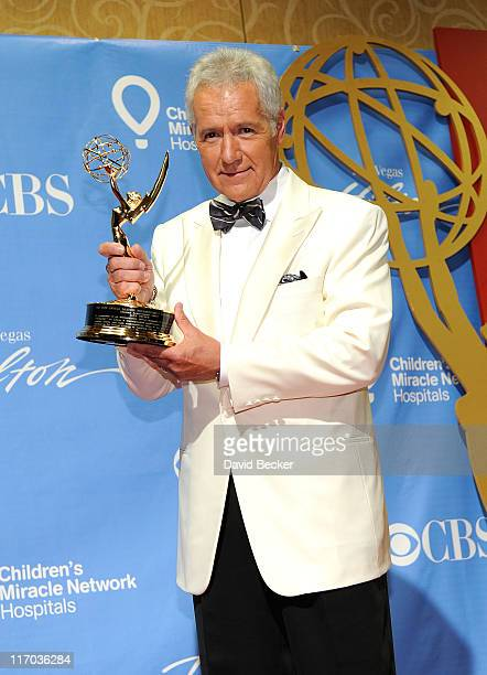 Lifetime Achievement Award honoree Alex Trebek poses in the press room at the 38th Annual Daytime Entertainment Emmy Awards held at the Las Vegas...