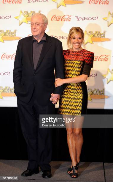 Lifetime Achievement Award recipient Michael Caine and Supporting Actress of the Year Sienna Miller poses for photos in the press room at ShoWest...