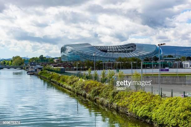 liffey river and aviva stadium in dublin, ireland - dublino irlanda foto e immagini stock