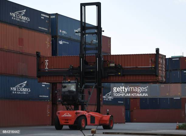 A lift carries a container at Oi container yard of the Tokyo port in Tokyo on May 18 2017 Japan has posted its longest economic expansion in over a...