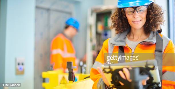lift engineers - electrician stock pictures, royalty-free photos & images
