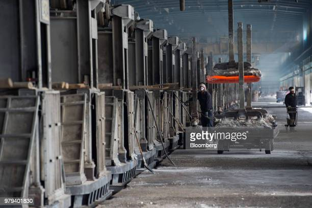 A lift loads a cart with heated aluminium ingots at the Iran Aluminium Co plant in Arak Iran on Tuesday June 19 2018 As OPEC oil ministers meet in...