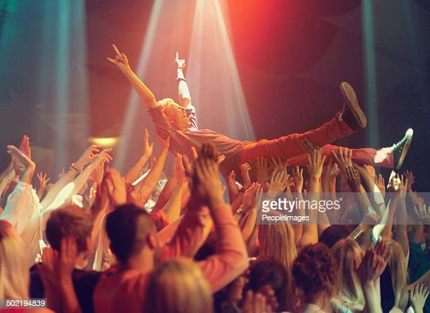 lift me higher! - concert stock pictures, royalty-free photos & images